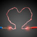 electricity arcing in a heart shape between two exposed wires