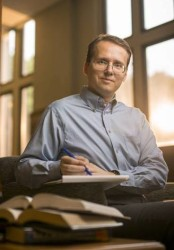 """Mattias Polborn New Faculty profile portrait for MyVU. Polborn is a political economist. Would like to photograph him """"at work"""" -- reading, pouring over notes, etc. in a casual, non-office setting, such as the Vanderbilt Library (Daniel Dubois / Copyright Vanderbilt University)"""
