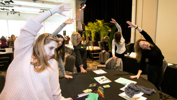 Desk yoga demonstration at the GO THERE campaign kickoff Jan. 27. (Joe Howell/Vanderbilt)