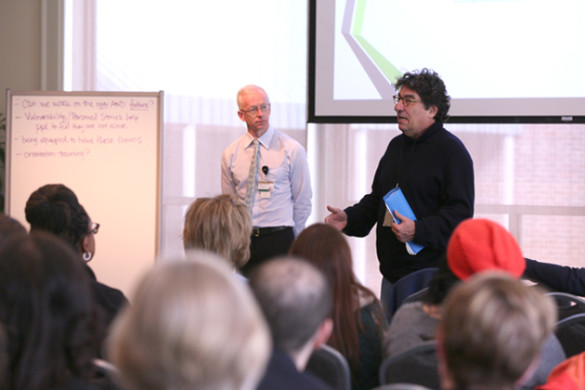Donald Brady (left), co-chair of the Chancellor's Strategic Planning Committee on Mental Health and Wellbeing, and Chancellor Nicholas S. Zeppos (right) speak at the Chancellor's Town Hall meeting Jan. 26. (Vanderbilt University)