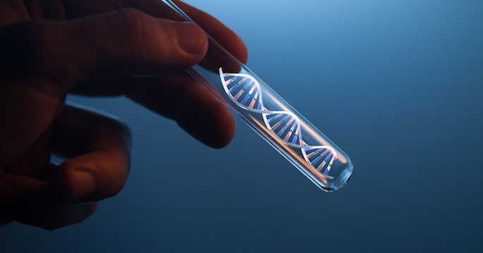 DNA molecule in glass tube in hand of scientist on blue