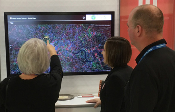 "Visitors to the ""Places and Spaces"" exhibition are invited to touch the data and engage with the macroscopes at a touchscreen kiosk. (image courtesy of Places and Spaces: Mapping Science)"