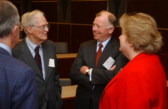 Daane (second from left) speaks with the late Harvey Goldschmid (second from right), then a member of the U.S. Securities and Exchange Commission, at the Owen School's Financial Markets Research Center Conference in 2003. (Daniel Dubois/Vanderbilt)