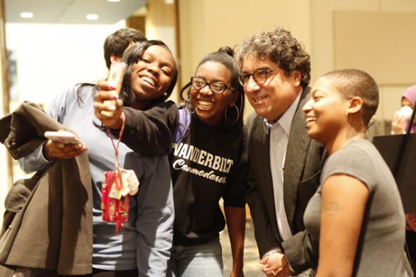 Chancellor Nicholas S. Zeppos poses for a selfie with students at the Mega Stress Fest Dec. 2 at the Student Life Center. (Daniel Dubois/Vanderbilt)