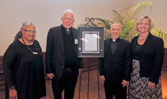 "L-r: Dean Emilie Townes, honoree Edward ""Monk"" Malloy, Bruce Morrill and Provost Susan R. Wente. (Steve Green/Vanderbilt)"