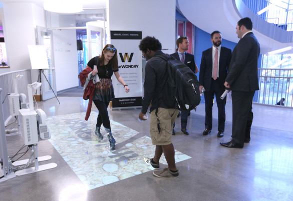 Students test out the interactive floor projection system at the Wond'ry open house Nov. 9. (Anne Rayner)