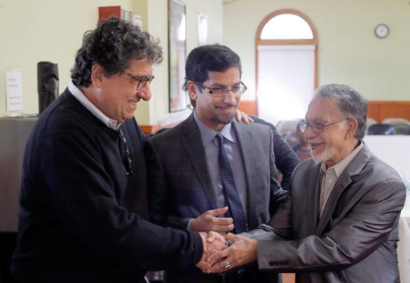 At the Islamic Center of Nashville, Chancellor Nicholas S. Zeppos talks with center president Rashed Fakruddin and Fakruddin's father as part of the Nov. 5 Chancellor Charter interfaith tour. (Steve Green/Vanderbilt)