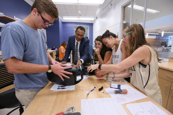 Professor of the Practice of Management and Innovation David Owens and students in his New Product Development class take apart and reassemble Oreck vacuum cleaners in a Wond'ry lab to better understand their price. (Anne Rayner/Vanderbilt)