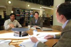 MBA students confer on a project in the Walker Management Library at the Owen School. (Daniel Dubois / Vanderbilt)