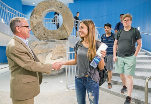 School of Engineering Dean Philippe Fauchet greets students on the first day of classes at the new Engineering and Science Building Aug. 24. (John Russell/Vanderbilt)