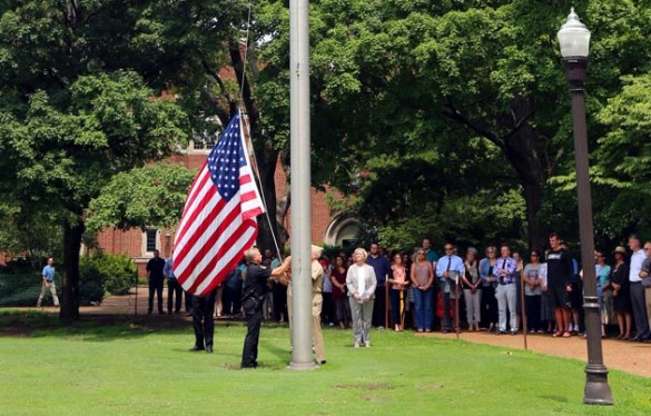 Provost and Vice Chancellor for Academic Affairs Susan R. Wente and members of the Vanderbilt community gathered on Alumni Lawn July 8 to lower the American flag in honor of police officers killed in Dallas, Texas, July 7. (Steve Green/Vanderbilt)