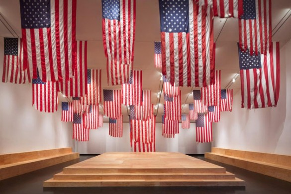 """Some of the American flags on display in Mel Ziegler's installation """"Flag Exchange,"""" now at the Tang Teaching Museum."""