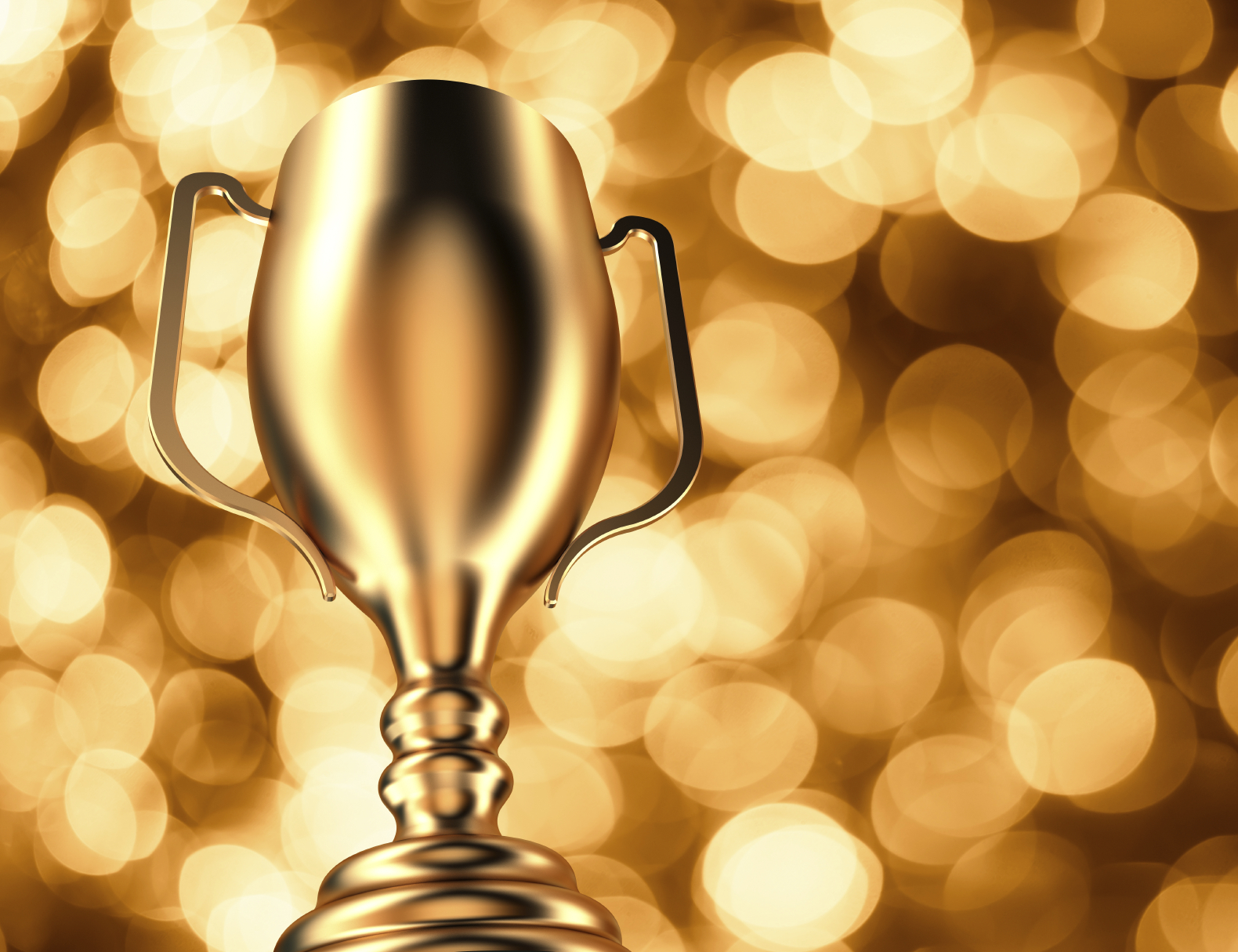 Gold Trophy on Gold Bokeh Background