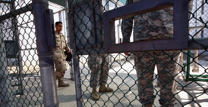 soldiers guarding gate at Guantanamo Bay