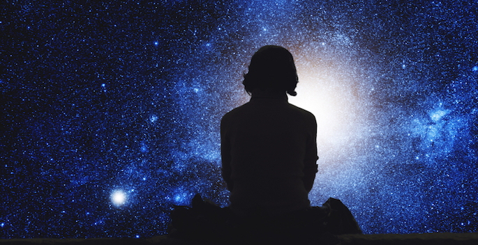 silhouette of girl looking at the stars