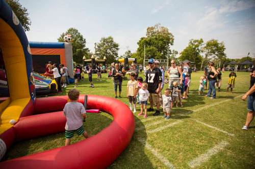 Young Commodore fans enjoyed inflatables and other games at the 2015 football tailgate.