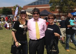L-r: Children's Hospital employee Brooke Austin, Chancellor Nicholas S. Zeppos and Austin's mother at the 2015 football tailgate.