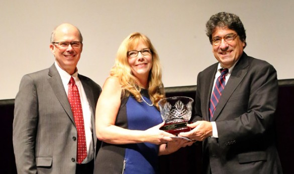 Chancellor Nicholas S. Zeppos (right) recognizes Commodore Award winner Judy Brandon (center) at the Service Awards Celebration Sept. 29, along with Associate Provost and Dean of Students Mark Bandas (left).