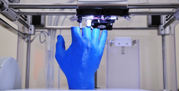 3D printer producing a blue colored hand