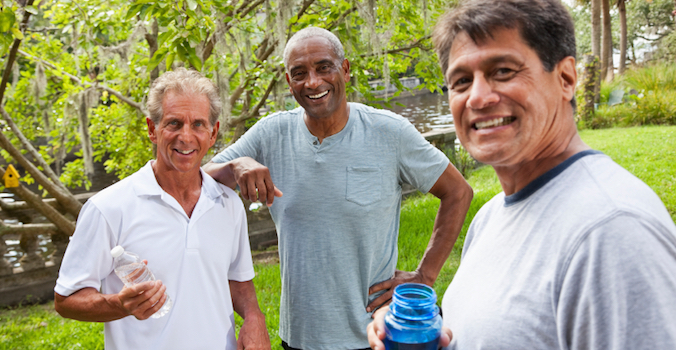 ethnically diverse senior men being active