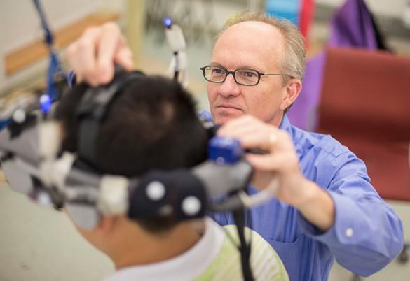 McNamara adjusting VR headset
