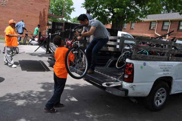 Dawei Li, a SEMO student intern, helps unload bicycles being donated to the Edgehill Bike Club.