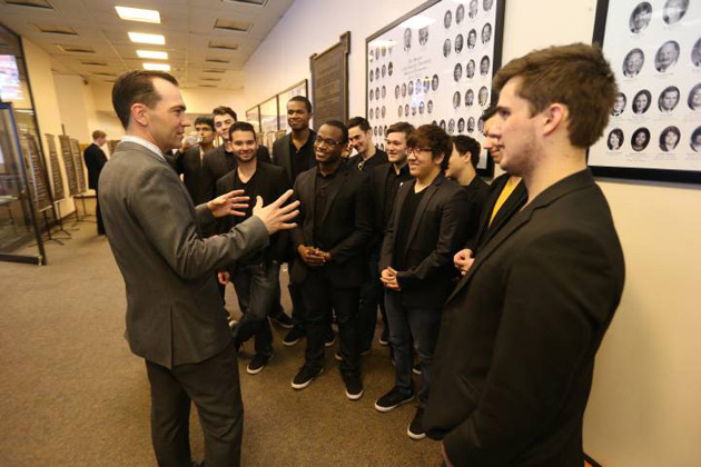 Rep. John Ray Clemmons (left), who represents the district that includes Vanderbilt, greets members of the Melodores, who entertained legislators in the hallways of Legislative Plaza. (John Russell/Vanderbilt)