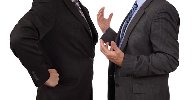 men in suits arguing