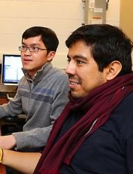 Zhou and Idrobo sitting at desk