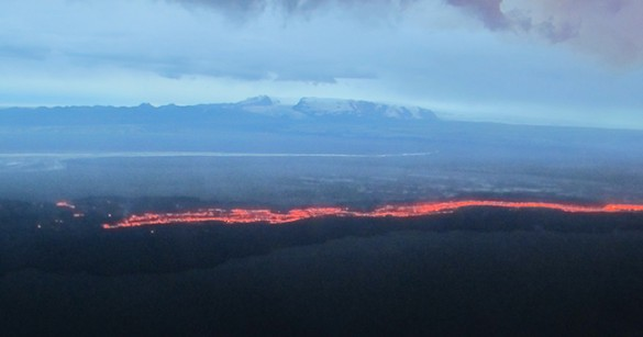mountain with flowing lava in foreground