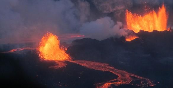 two volcanoes erupting