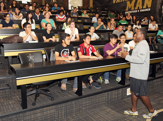 Head football coach Derek Mason speaks to international students and scholars at the McGugin Center Aug. 25. (Steve Green/Vanderbilt)