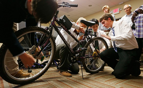 Students working on bike