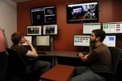 Researchers sitting at computers looking at monitors