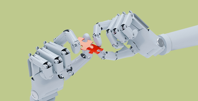 Robotic hands holding puzzle pieces