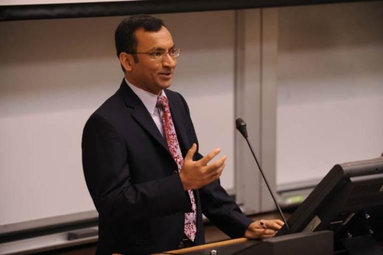 Ramanujam speaking at a podium