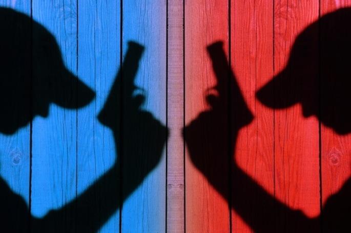 silhouette of armed men