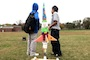 Seventh grade students at Wright Middle School in Nashville standing next to their brightly decorated soda bottle rocket sitting on the launch pad.
