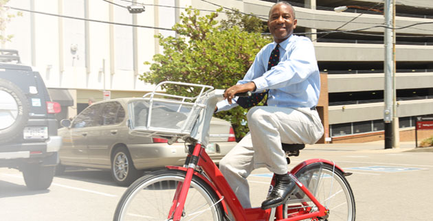 Community Neighborhood and Government Relations' David Mills takes one of the b-cycles for a spin. (Steve Green/Vanderbilt)