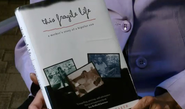 "Charlotte Pierce-Baker holds her book ""This Fragile Life: A Mother's Story of a Bipolar Son."" (Jenny Mandeville/Vanderbilt)"