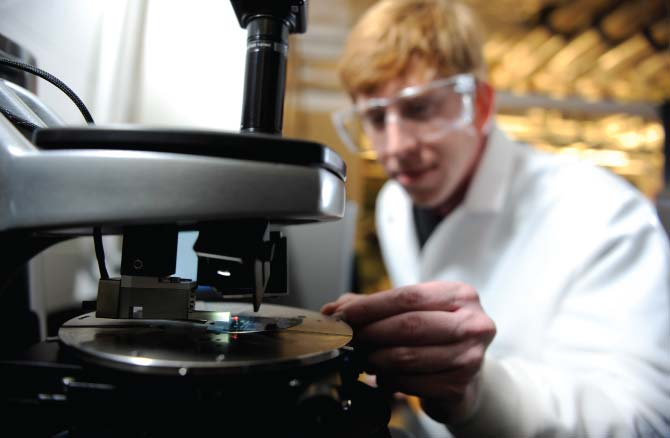 Student in lab using profilometer