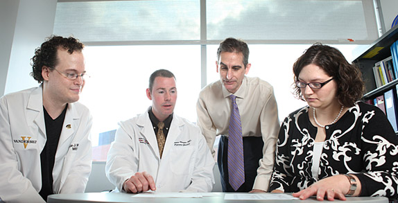 Louis Muglia, second from right, and colleagues, from left, Jude McElroy, Thomas Morgan, and Tracy McGregor, are studying genes associated with preterm birth. (photo by Susan Urmy)