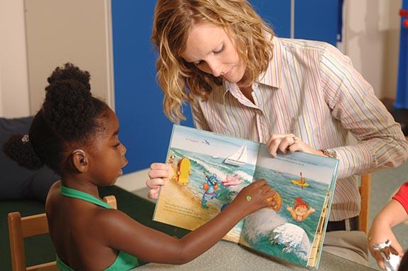 volunteer reading to child