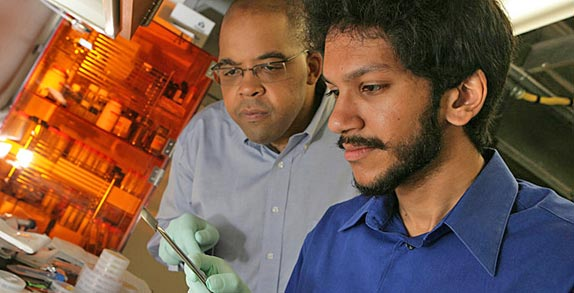 Physicist James Dickerson, left, and graduate student Saad Hasan (Photo by Daniel Dubois)
