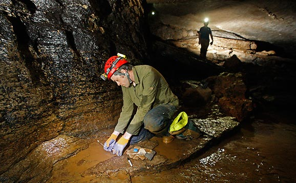 Brian Bachmann collecting bacterial samples in Snail Shell Cave