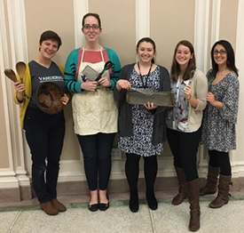 A team of graduate students (left to right) Kate Chazin, Danielle Bartelmay, Lillian Stiff, Sarah Reynolds, and Monica Rigor taught Adam to follow written recipes.