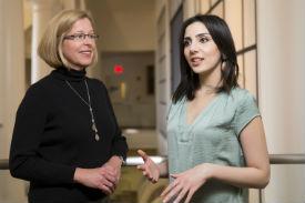 Eid, right, with Professor Krisen Neal