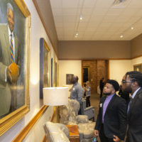 Individuals looking at the Vanderbilt Trailblazer portraits in Kirkland Hall (Vanderbilt University/Joe Howell)