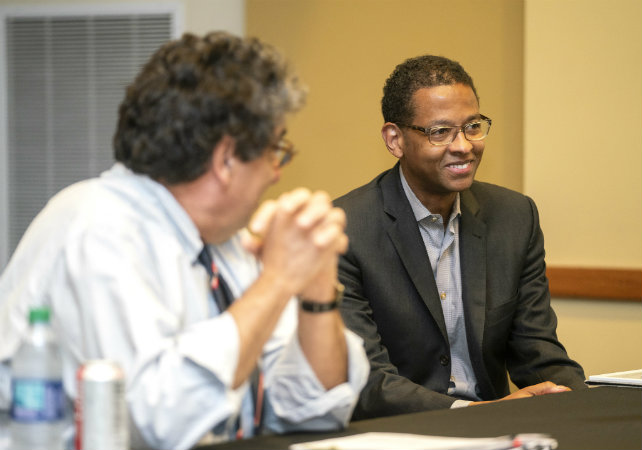 Left to right: Chancellor Nicholas S. Zeppos and NFL executive and Law School alumnus Adolpho A. Birch III meet with students at the Black Cultural Center