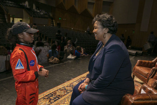 Mae Jemison speaks with a local second-grader who dressed up as the former astronaut for a school report earlier in the day. (Anne Rayner/Vanderbilt)
